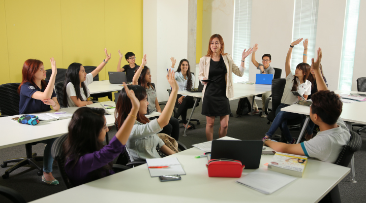 Taylor's students asking questions in the classroom